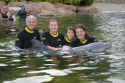 Swimming with dolphins at Discovery Cove (Photo credit: Discovery Cove, source Discovery Cove)